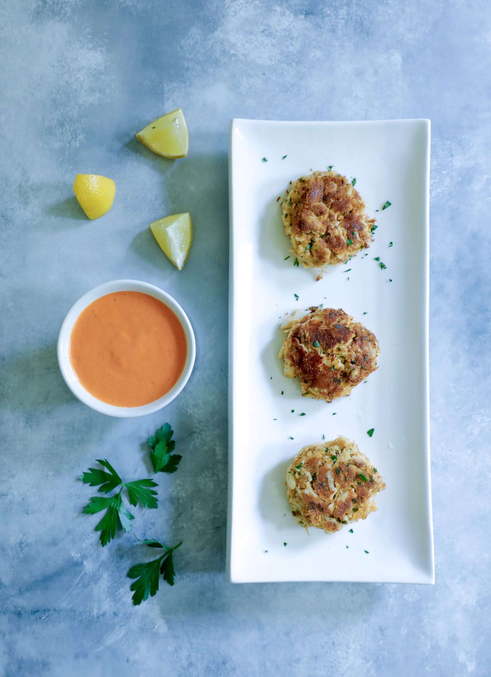 Keto crab cakes shown appetizer sized.