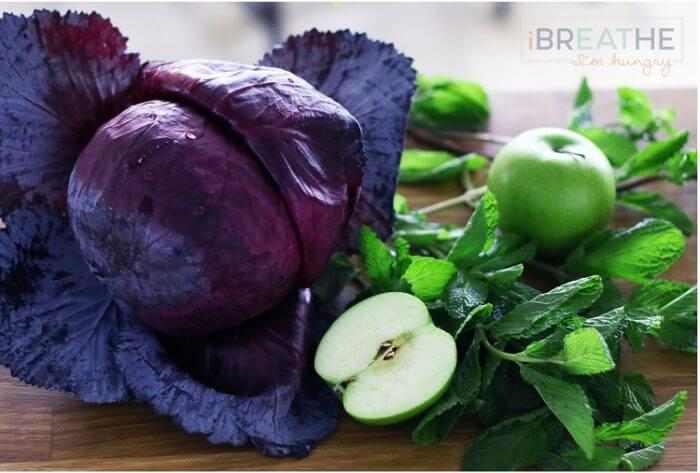 This Low Carb Red Cabbage, Mint, and Granny Smith Apple Slaw is not only gorgeous, it's also cheap, easy, super healthy for you, and tastes amazing! ibreathimhungry.com