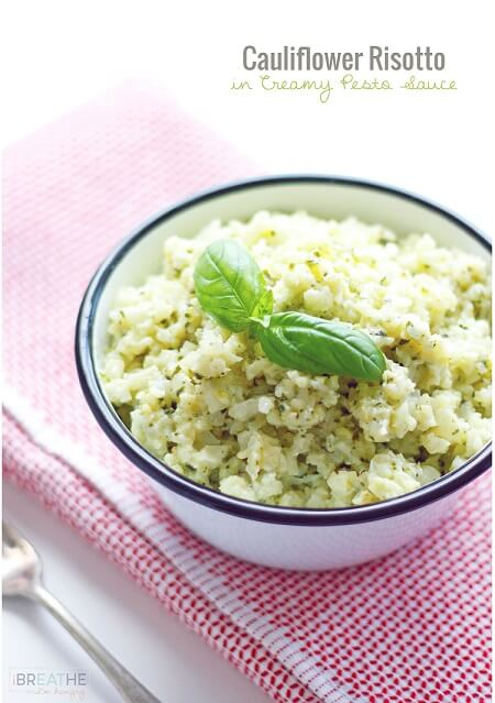 This versatile low carb side dish recipe perfectly mimics a classic risotto but is made with cauliflower in a cheesy pesto sauce. Keto and Atkins friendly.