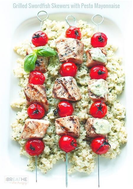 Easy and loaded with flavor, these grilled swordfish skewers with pesto mayonnaise are Keto, Atkins, and Paleo friendly!