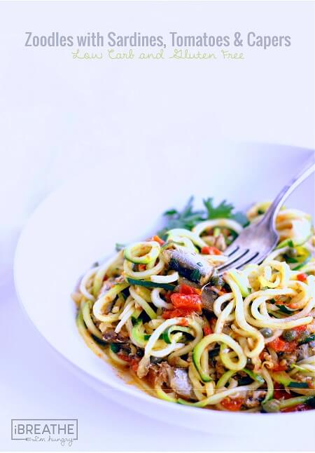 This low carb zucchini recipe contains super healthy sardines, garlic, tomatoes, capers and fresh herbs. Easy and delicious, it's also Paleo and Whole 30 approved!!