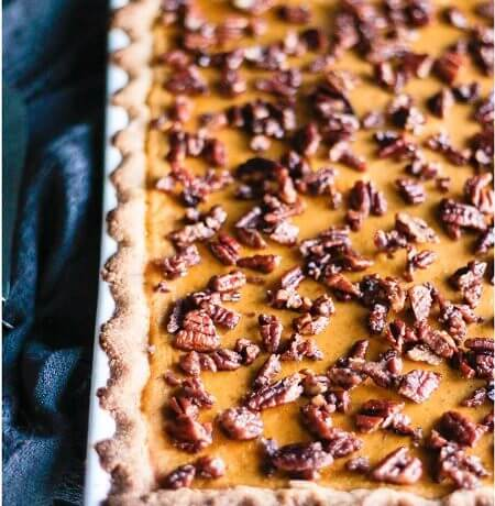 This low carb and gluten free pumpkin slab pie is my new favorite! The Cardamom Candied Pecans on top take it to the next level! Keto & Atkins friendly.