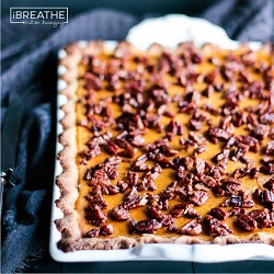 This low carb and gluten free pumpkin slab pie is my new favorite! The Cardamom Candied Pecans on top take it to the next level! Keto & Atkins friendly. From Mellissa Sevigny of I Breathe Im Hungry.