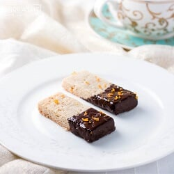 These delectable low carb shortbread cookies from Mellissa Sevigny from I Breathe Im Hungry are flavored with cardamom and clementine zest, then dipped in dark chocolate! Gluten free too!