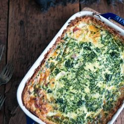 This low carb breakfast casserole has a crunchy crust and a delicious ham, cheese and spinach filling! Gluten Free