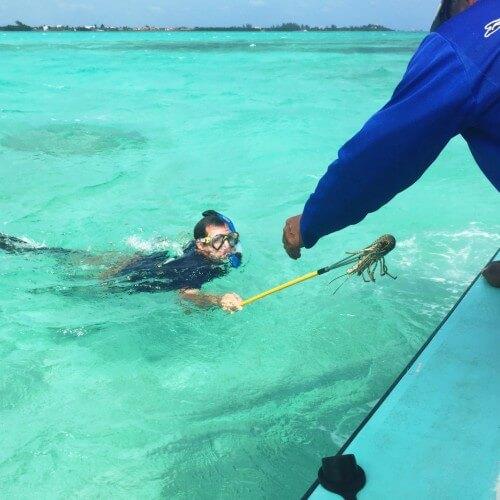 Matt spearfishing lobsters in Belize