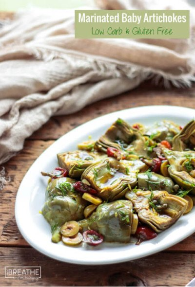 This low carb baby artichoke salad is loaded with bright flavors and will class up any antipasto platter!