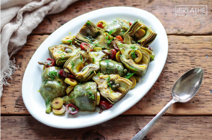 A delicious low carb and gluten free antipasto salad featuring marinated baby artichokes!