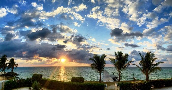 sunrise over the caribbean in belize taken by Mellissa Sevigny of I Breathe Im Hungry