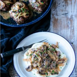 Baked in the oven, these easy low carb Salisbury Steaks are tender & delicious served with mushroom gravy.