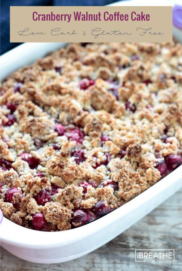 This low carb cranberry walnut coffee cake boasts a subtly orange flavored cake with a burst of tart cranberries & a toasty walnut streusel topping! Keto, Atkins, Gluten Free