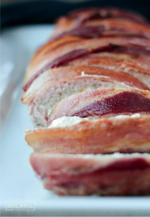 A delicious pork meatloaf stuffed with jalapeño popper filling and wrapped in bacon!