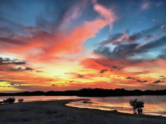 A gorgeous sunset near Mahogany Bay on Ambergris Caye by Mellissa Sevigny