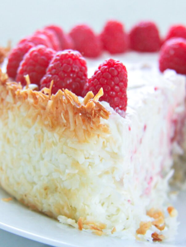 A gorgeous no bake keto raspberry cheesecake recipe with a hint of lemon and a coconut macaroon crust!