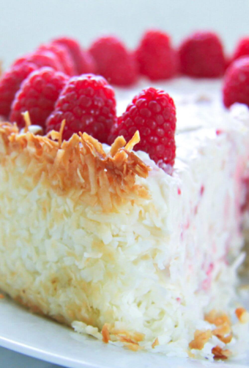 A gorgeous keto cheesecake recipe with raspberries, a hint of lemon and a coconut macaroon crust!