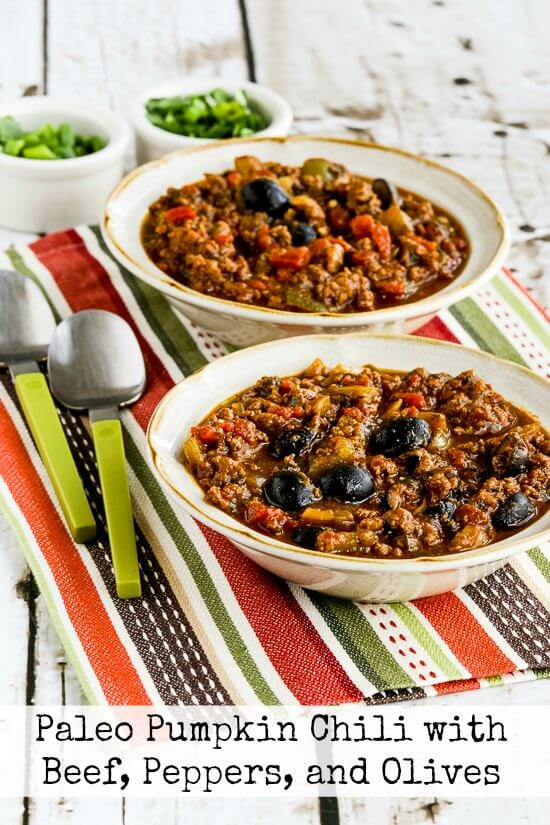 two bowls of low carb beefy pumpkin chili with black olives