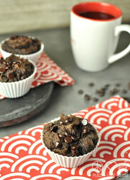 chocolate chip pumpkin muffins on red napkin with coffee