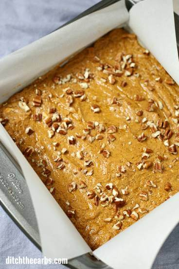 Pan of sugar free pumpkin fudge with nuts on top - 125 best keto pumpkin recipes!