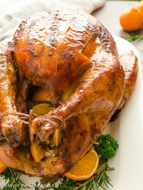 Roasted turkey with oranges on platter