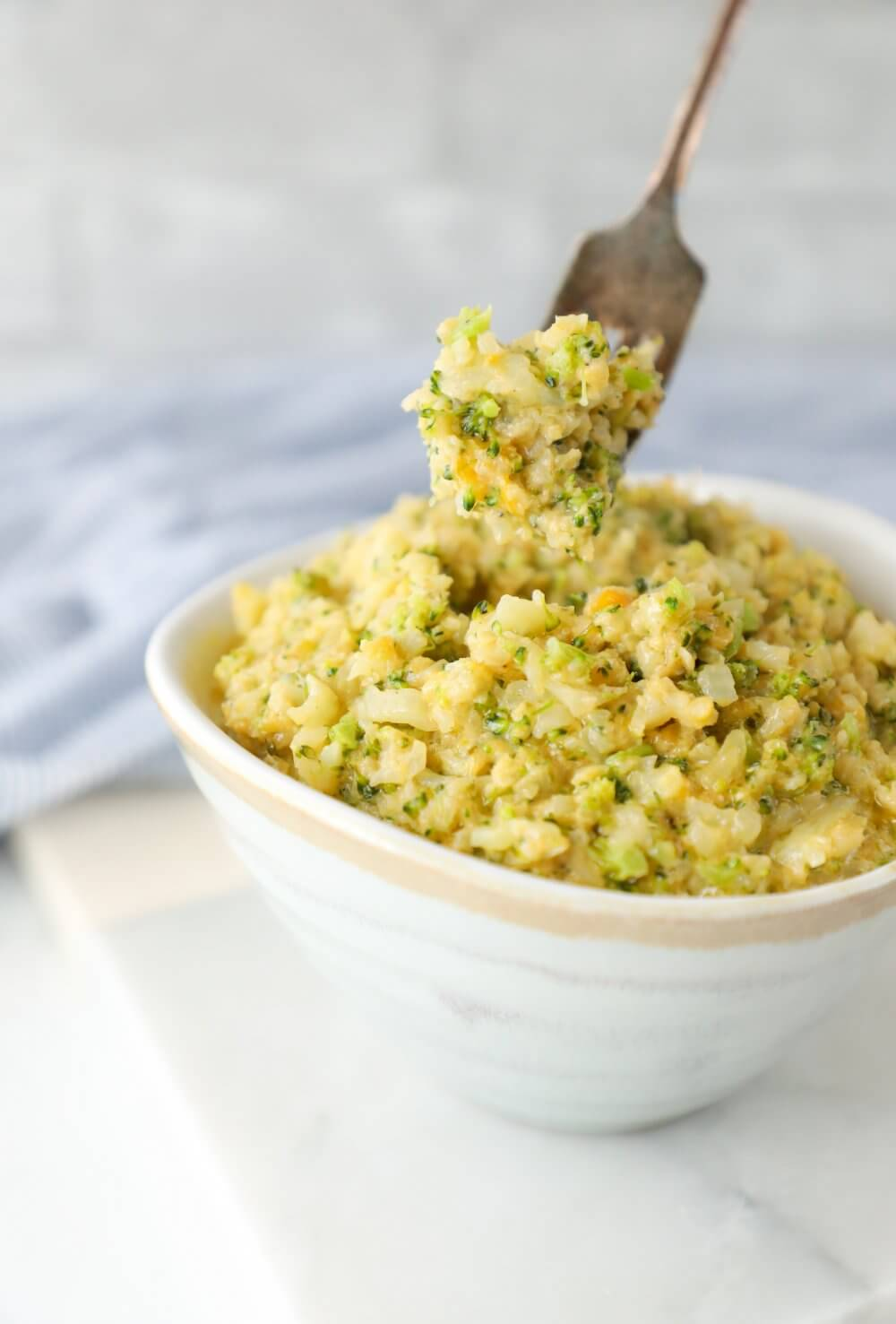 Forkful of Keto Cheesy Broccoli & Cauliflower Rice