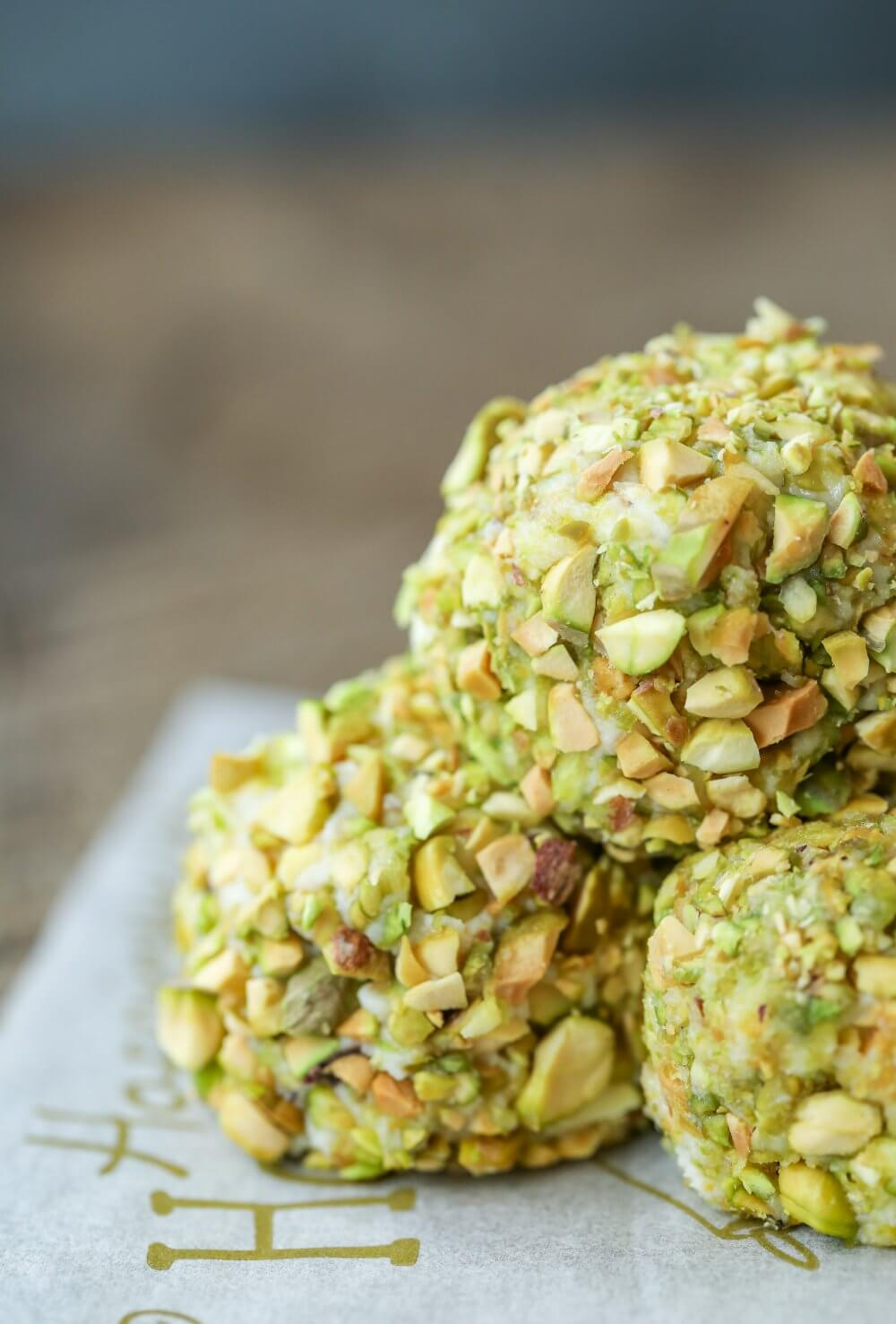 Closeup of 3 stacked Keto Pistachio Truffles on parchment