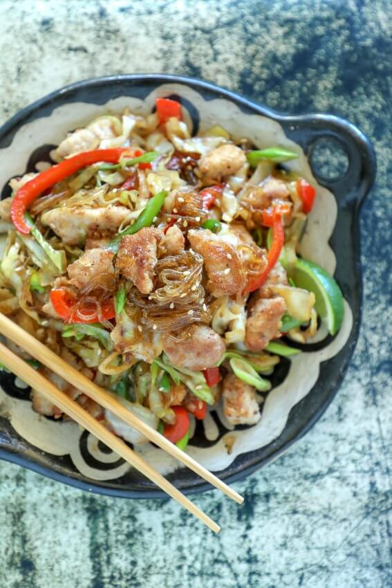 Keto Crispy Pork & Noodle Stir Fry on black and white plate
