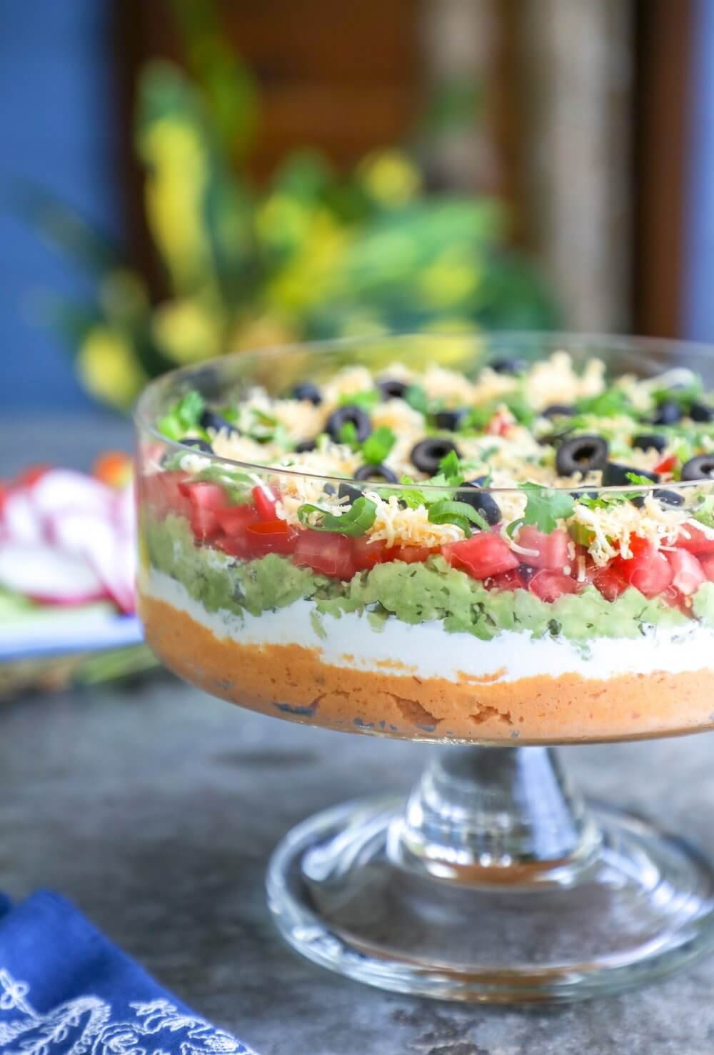 Front view of keto 7 layer dip layers through glass