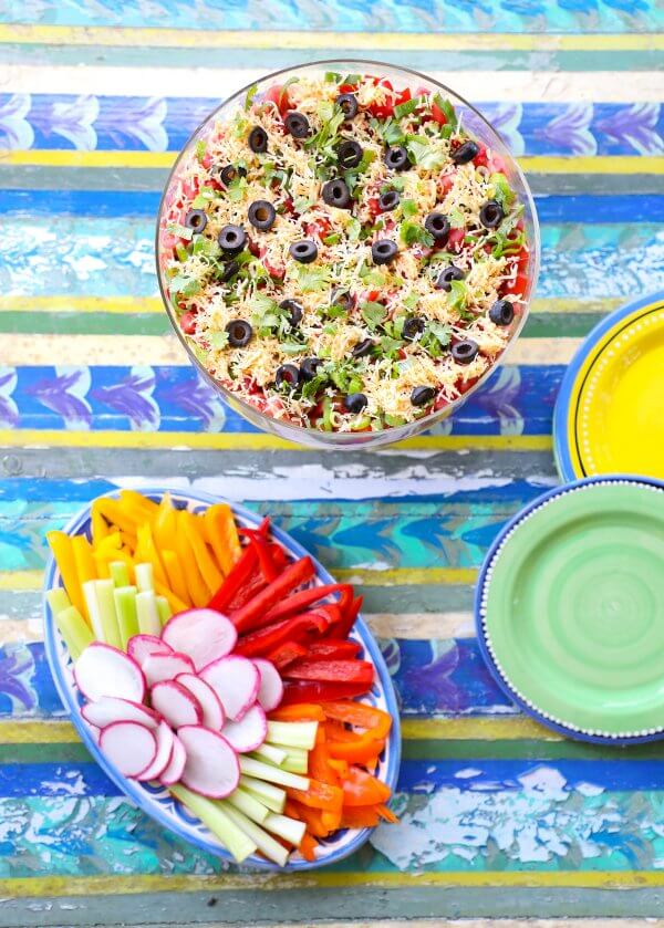 Top view of Keto 7 Layer Dip on Colorful tabletop