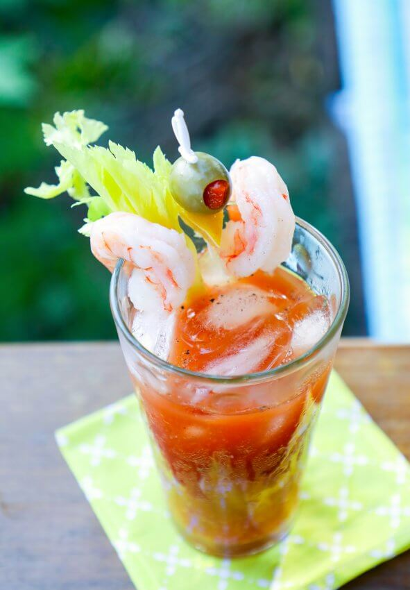 Keto Bloody Mary top view with shrimp and olive garnish