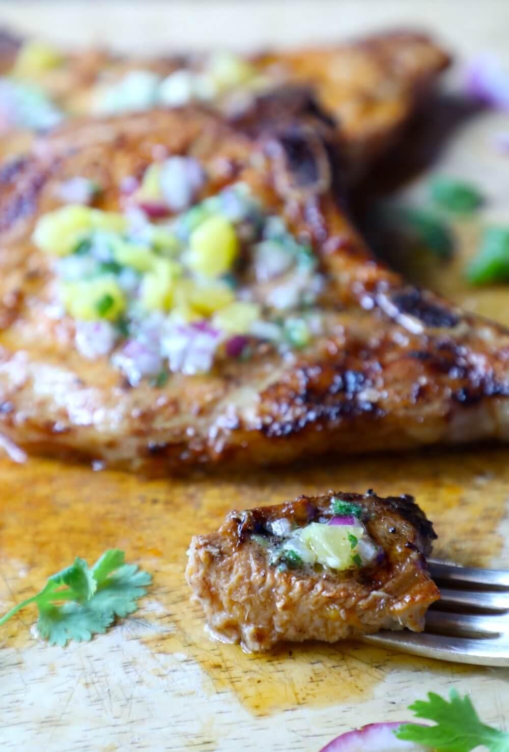 Keto Pork Chops al Pastor - one bite on a fork