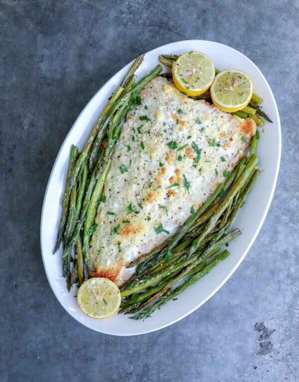 Keto Sheet Pan Salmon & Asparagus on grey concrete background