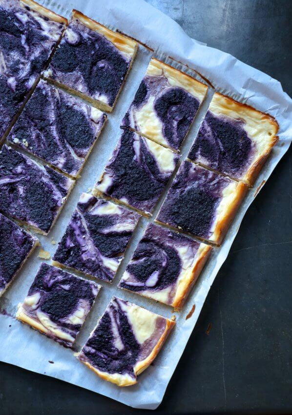 Easy Keto Blueberry Cheesecake Bars on black background