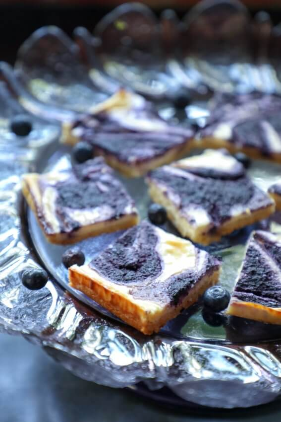 Easy Keto Blueberry Cheesecake Bars on purple cake plate