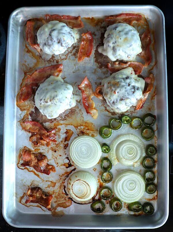 Keto Sheet Pan Burgers with Bacon & Jalapeño on the pan