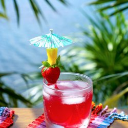 Easy Keto Rum Punch with strawberry and pineapple garnish