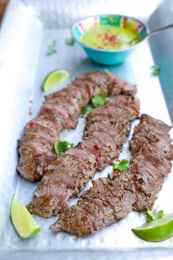 Keto Carne Asada with Chimichurri on a sliver platter