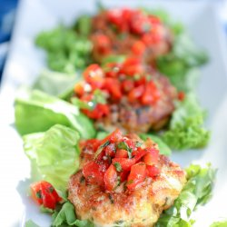 Keto Fish Cakes with Salsa on a bed of lettuce
