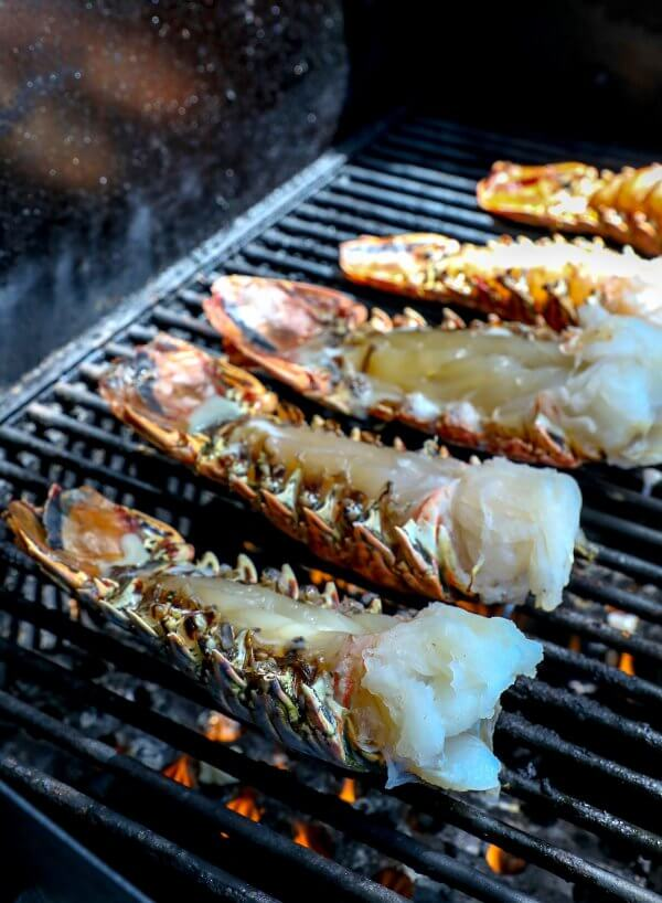 Keto Grilled Lobster Tails with Creole Butter on grill
