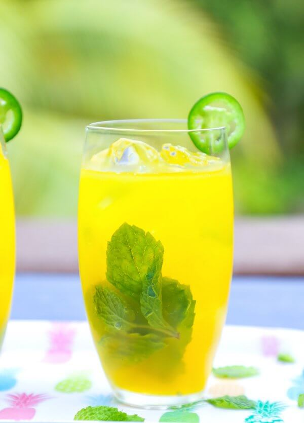 Keto Spicy Mango Mojitos with jalapeño and mint garnish