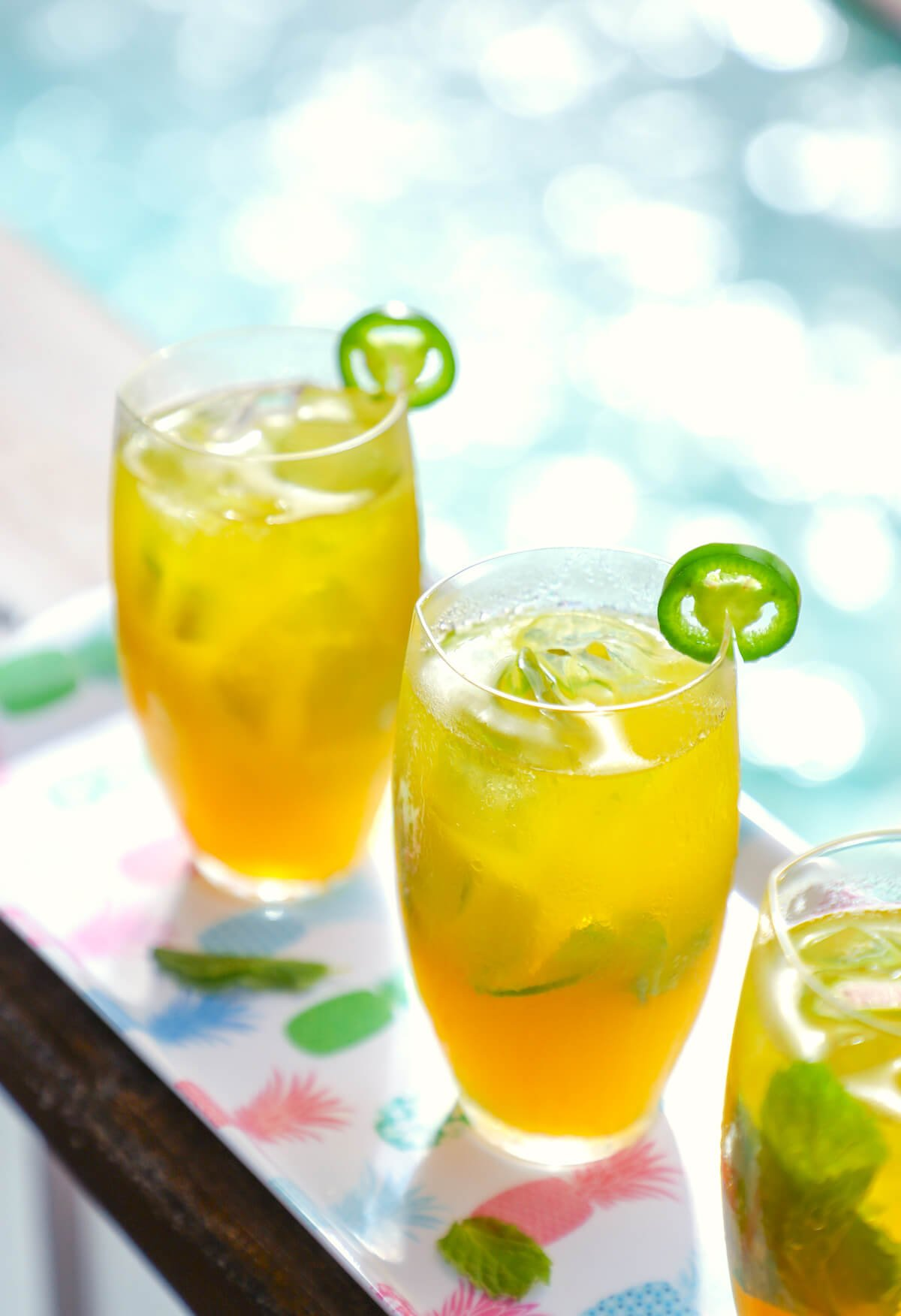 Refreshing and colorful, these keto spicy mango mojitos have a hint of heat to offset the sweet.  They are low carb cocktail perfection.