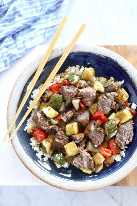 Keto Sheet Pan Hibachi Beef & Vegetables on a blue plate with chopsticks