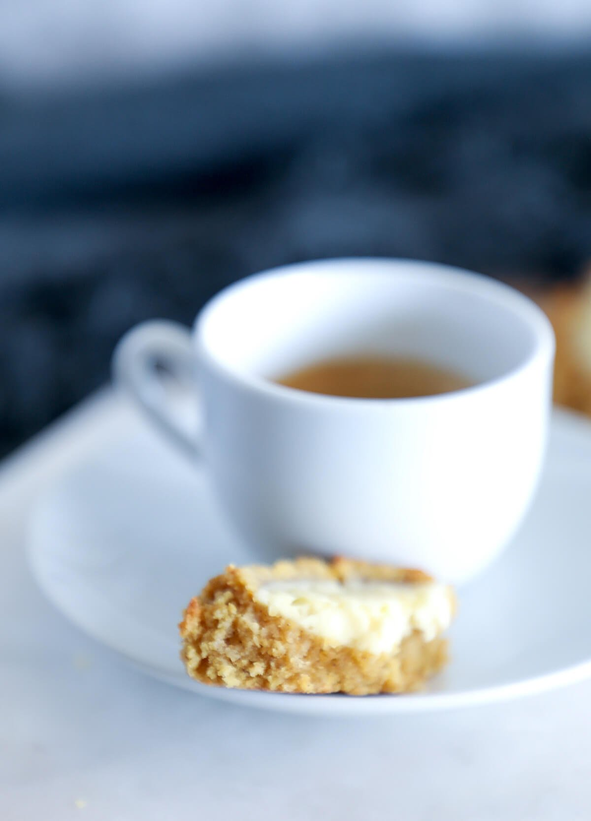 Keto Pumpkin Cheesecake Thumbprint cookies served with coffee in a white mug