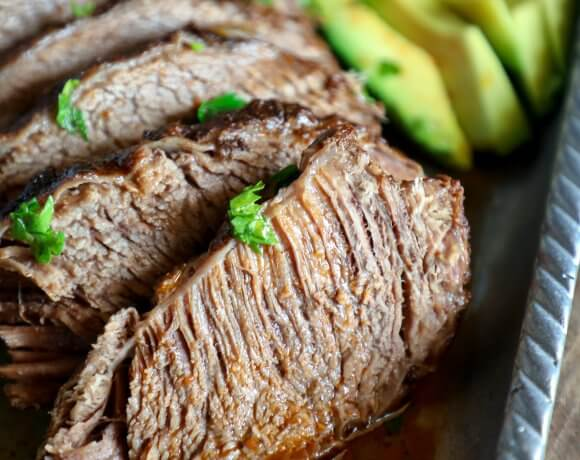 Keto Beef Brisket in the Instant Pot with sliced avocado