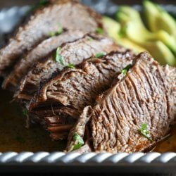 Keto Beef Brisket in the Instant Pot sliced with avocado garnish