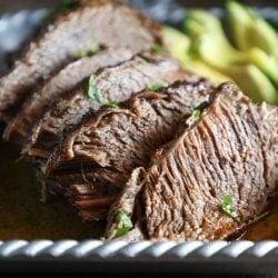 Keto Beef Brisket in the Instant Pot sliced with avocado garnish