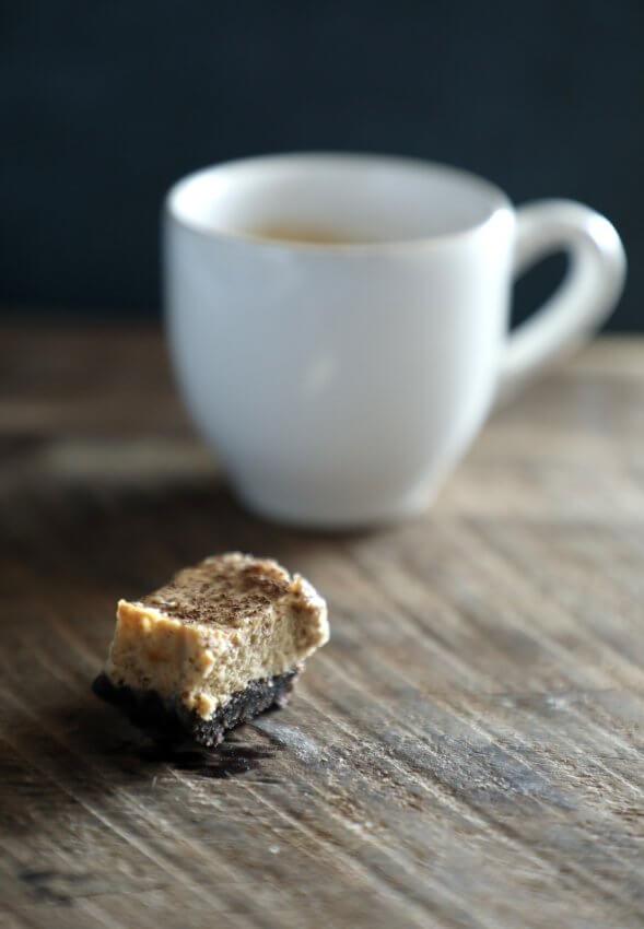 keto espresso chocolate cheesecake bars with espresso cup in background