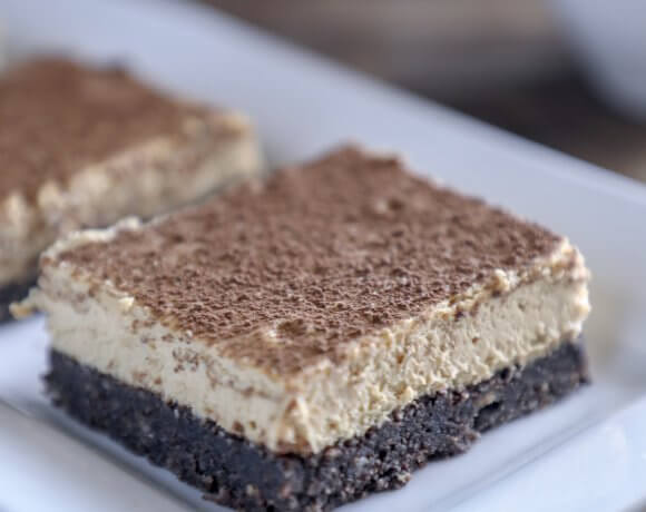 keto espresso cheesecake bars on white rectangular plate