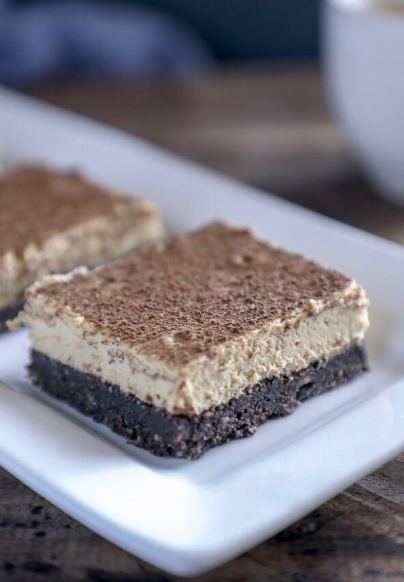 keto espresso chocolate cheesecake bars on white rectangular plate