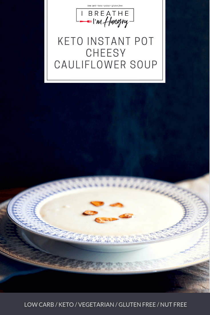 This Instant Pot Keto Cheesy Cauliflower Soup is delightfully lush and creamy, with a rich flavor that will keep you coming back for more. Make this low carb cauliflower soup in just minutes in your Instant Pot, but it also works on the stovetop or in a slow cooker! Vegetarian too!  #ketorecipes #vegetarianketo #instantpotrecipes #instantpotsoups