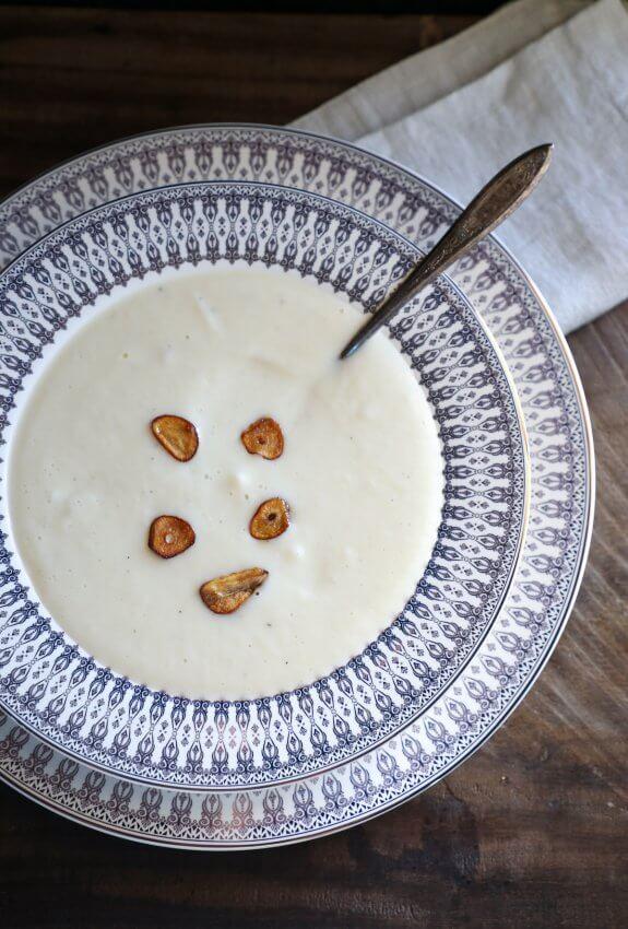 Instant Pot Keto Cheesy Cauliflower Soup with fried garlic garnish